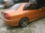 Foto Mitsubishi lancer evo 4 orange