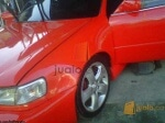 Foto Toyota New Corola th 2000 AT Merah