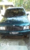 Foto Isuzu Panther 2.3cc th 1995 warna hijau botol