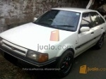 Foto Ford laser ghia TX3 th 1986 warna putih