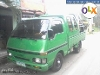 Picture Isuzu elf DROP-SIDE with aircon neg. Rush