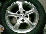 Picture Honda civic fd stock mags 15 inches 5 holes...